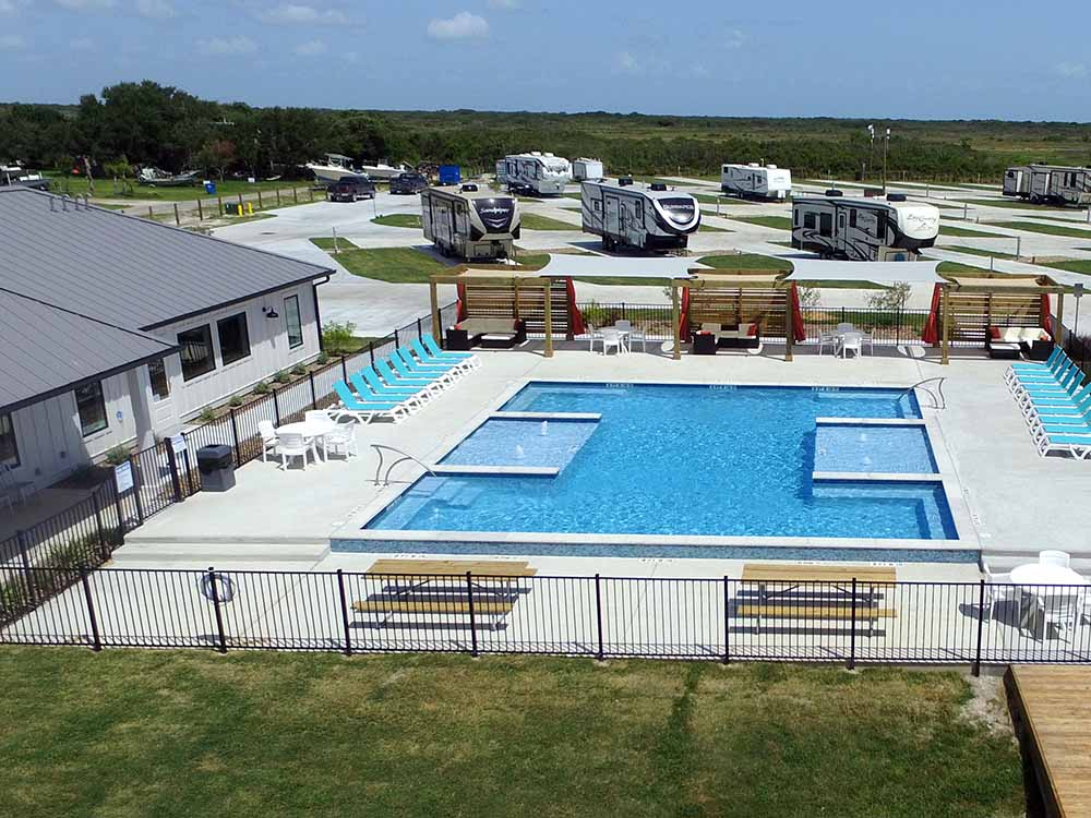 View of pool area and RVs beyond at R  R RV RESORT  CASITAS