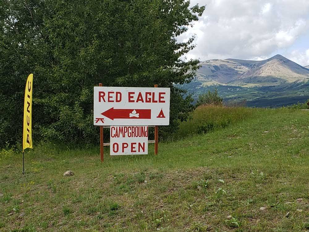 Mountain landscape with park sign at RED EAGLE CAMPGROUND