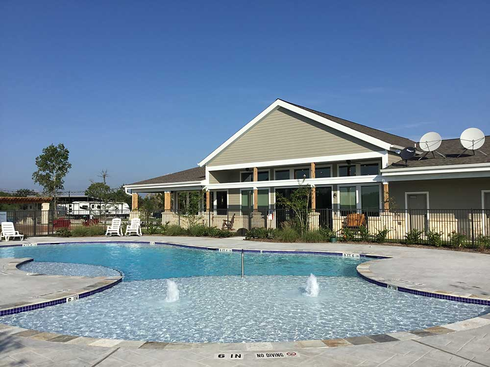 View of swimming pool and office at JETSTREAM RV RESORT AT NASA