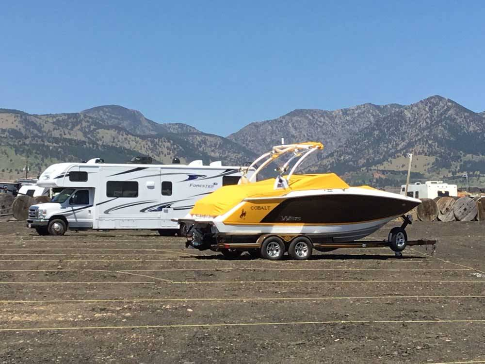 A boat and a motorhome parked at UNCLE JONS OUTDOOR STORAGE WEST