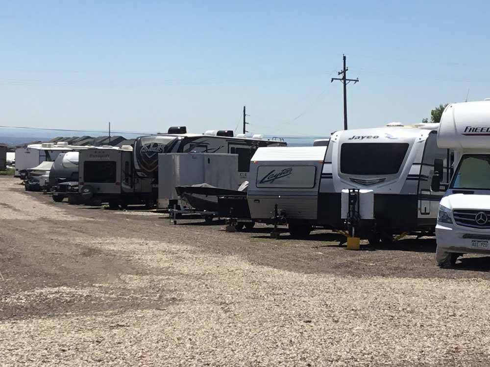 A row of RVs in outdoor storage at UNCLE JONS OUTDOOR STORAGE