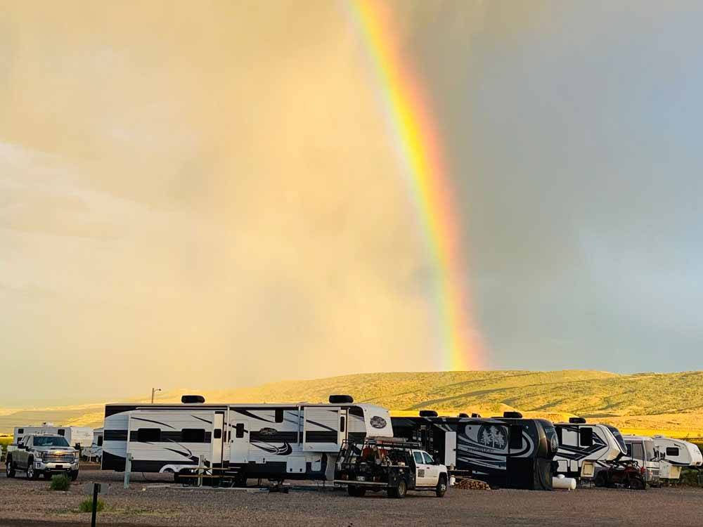 A rainbow over the campsites at TRAIL  HITCH RV PARK AND TINY HOME HOTEL