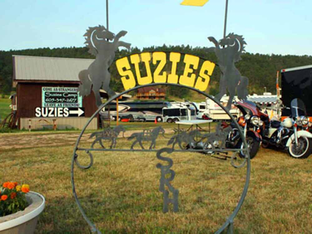 The front entrance sign on the side of a building at SUZIES CAMP
