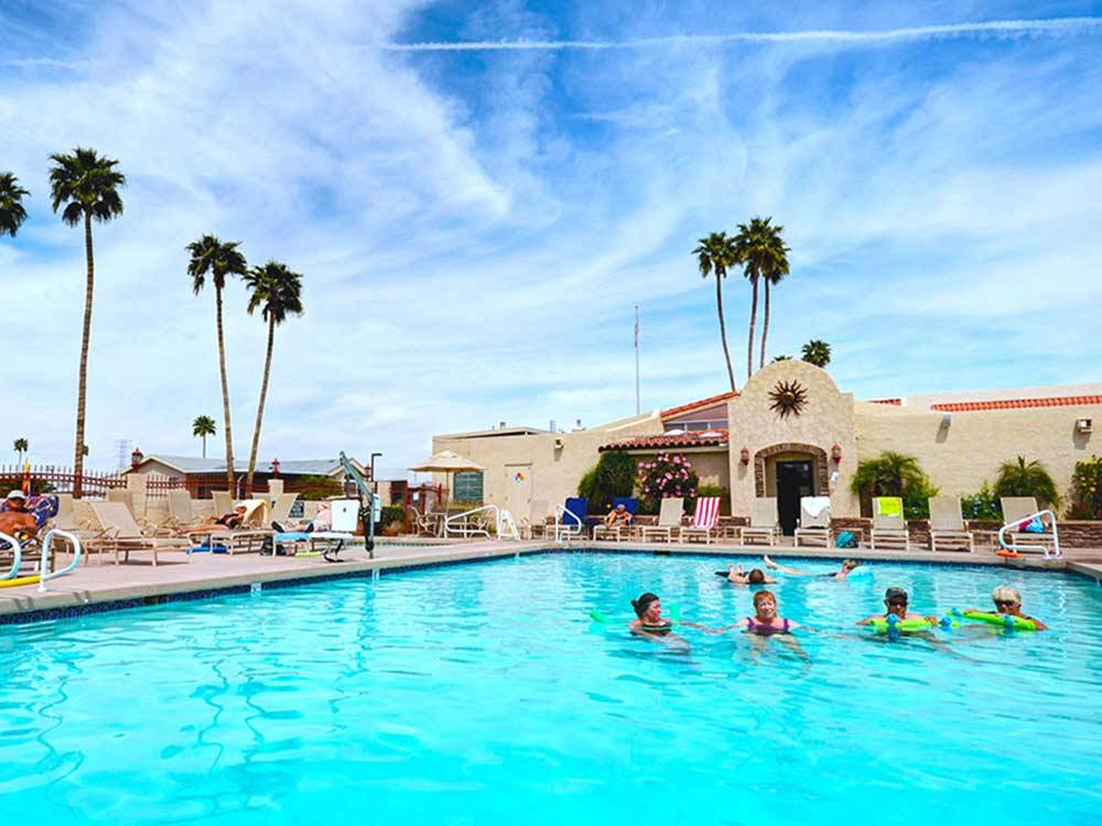 People swimming in pool at VAL VISTA VILLAGE RV RESORT
