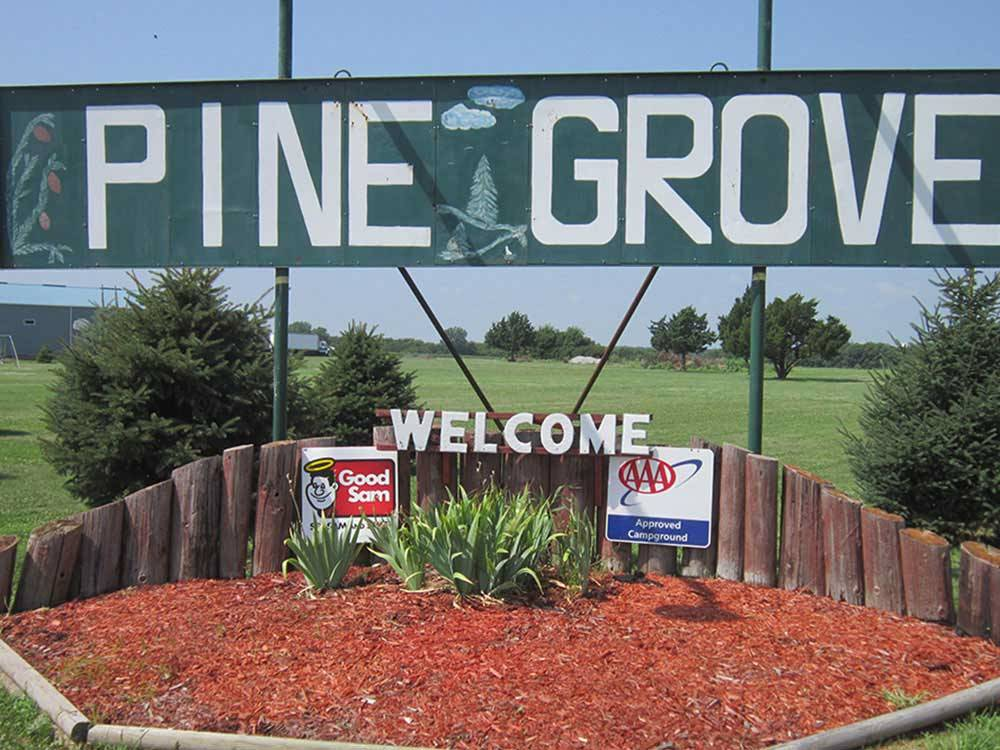 Welcome sign at entrance at PINE GROVE RV PARK