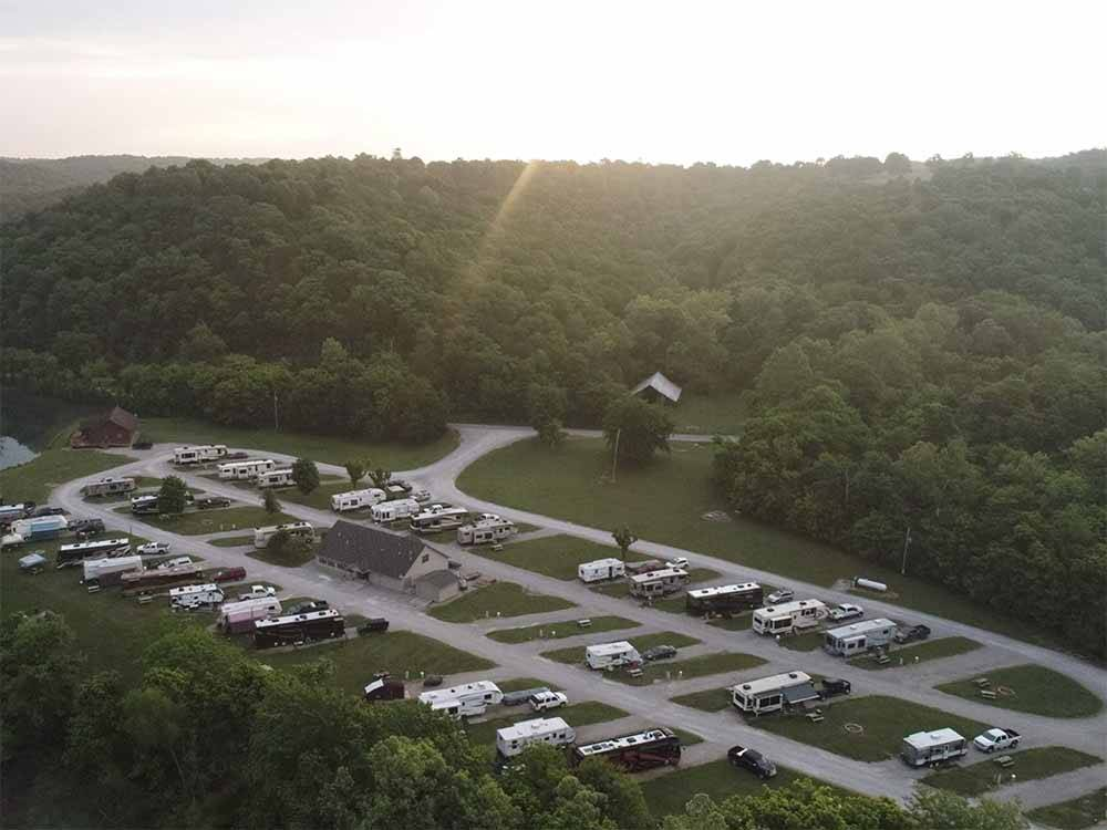 Aerial view over motorhomes and lake at DENTON FERRY RV PARK  CABIN RENTAL