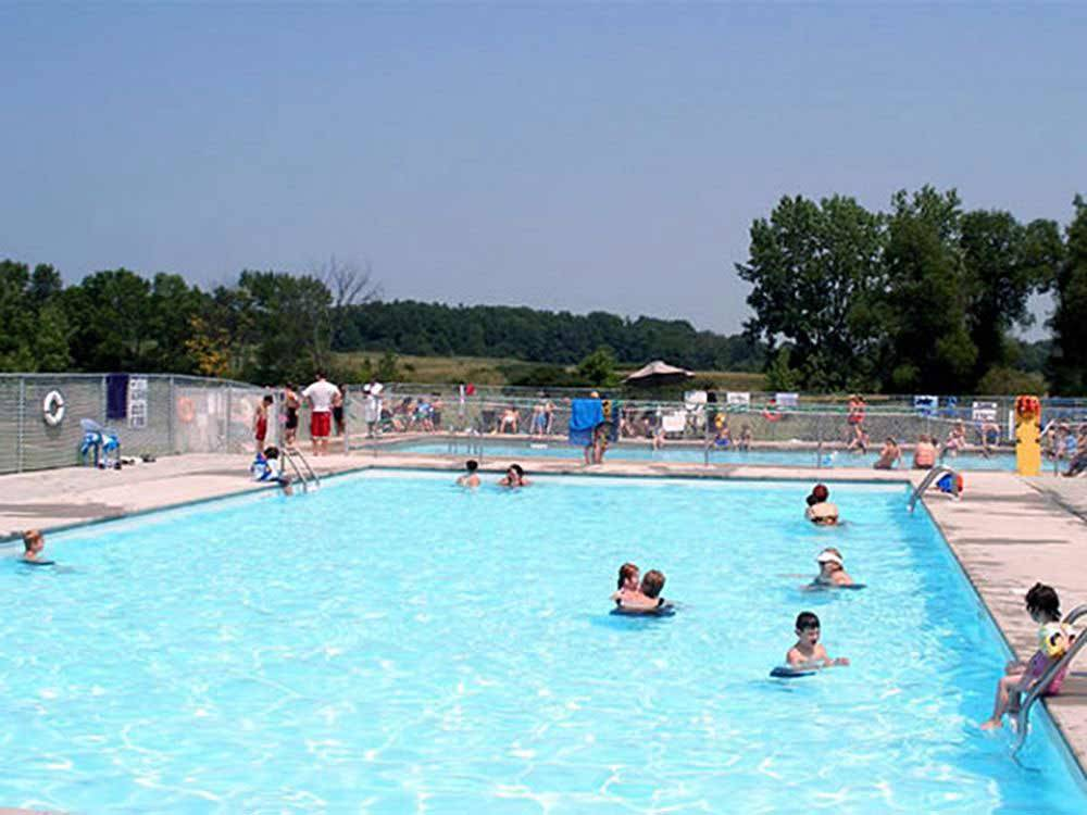 People swimming in pool at NET CAMPING RESORT