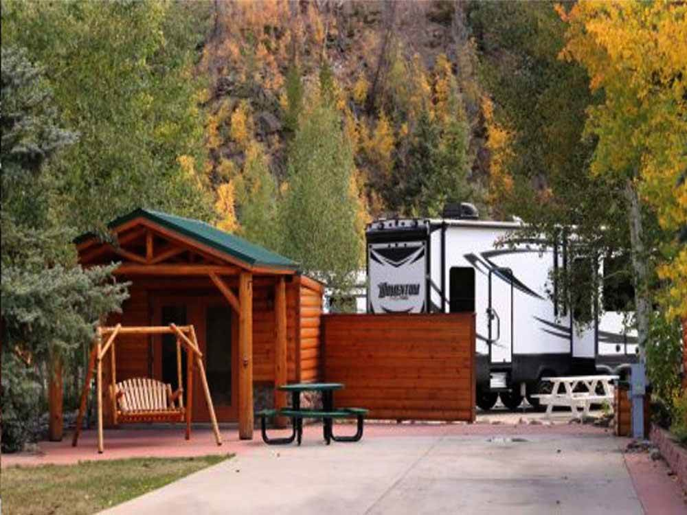 One of the camping cabins with a swing out front at TIGER RUN RESORT