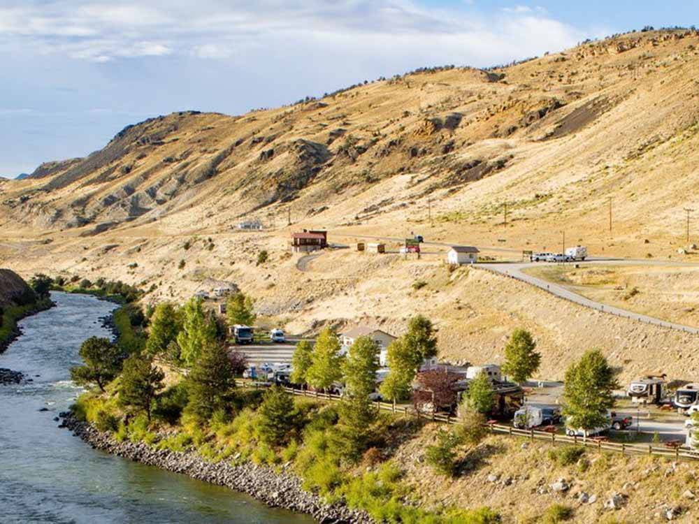 RV sites overlooking a river at YELLOWSTONE RV PARK