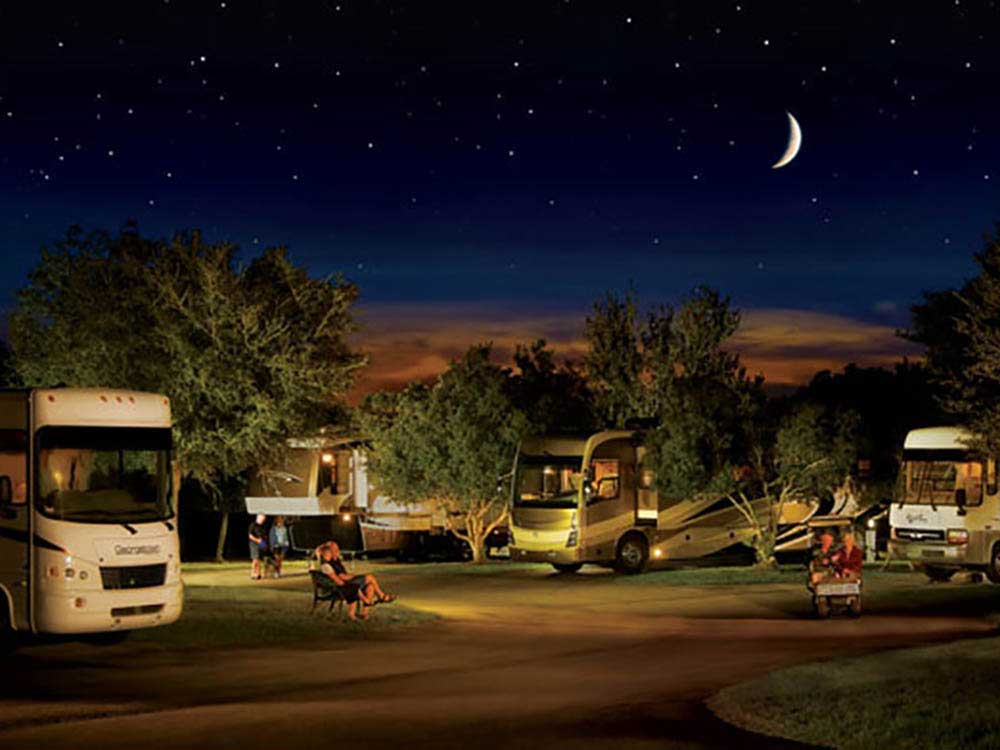 RVs camping at night at LAZYDAYS RV RESORT