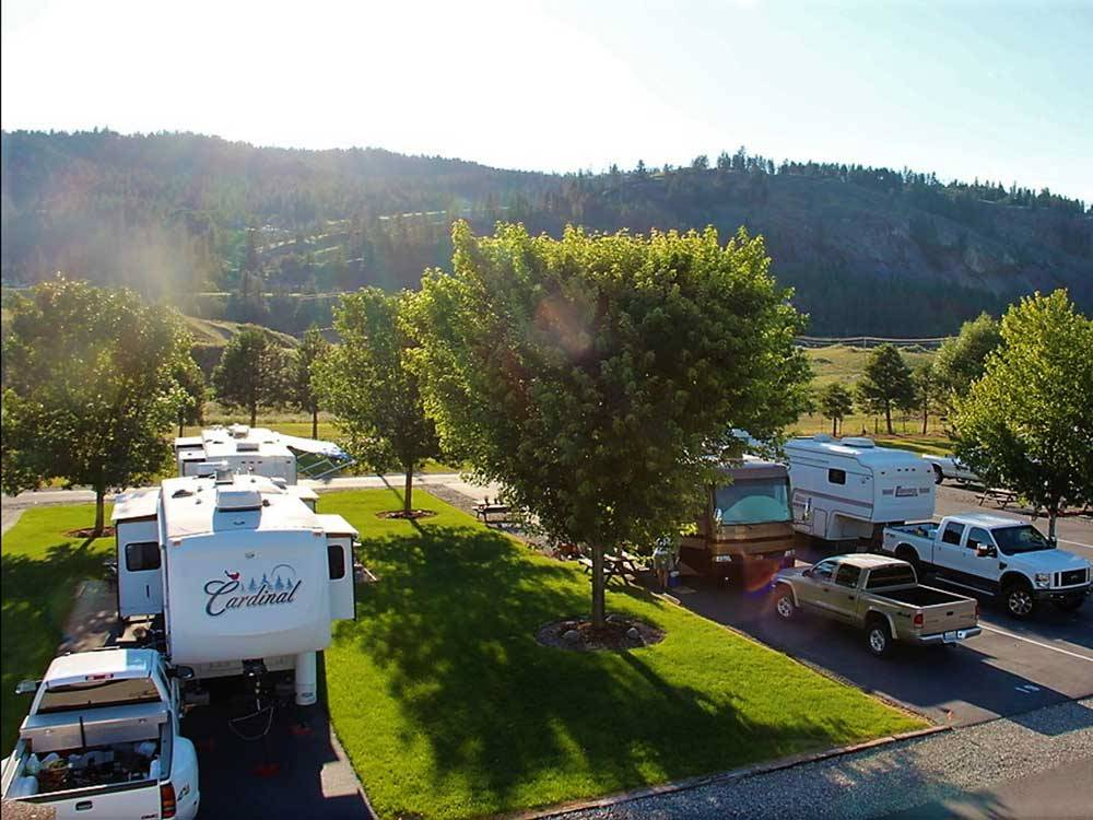 RVs parked in grassy sites with paved pads at WINCHESTER RV PARK