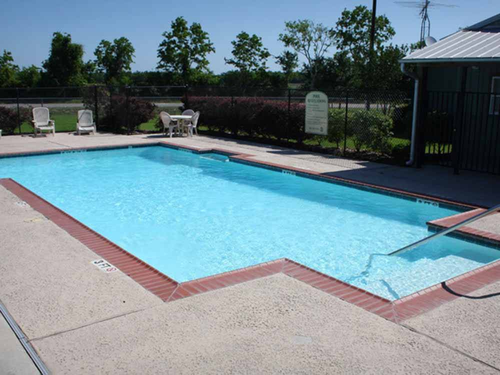 American and Texas flags waving at GULF COAST RV RESORT