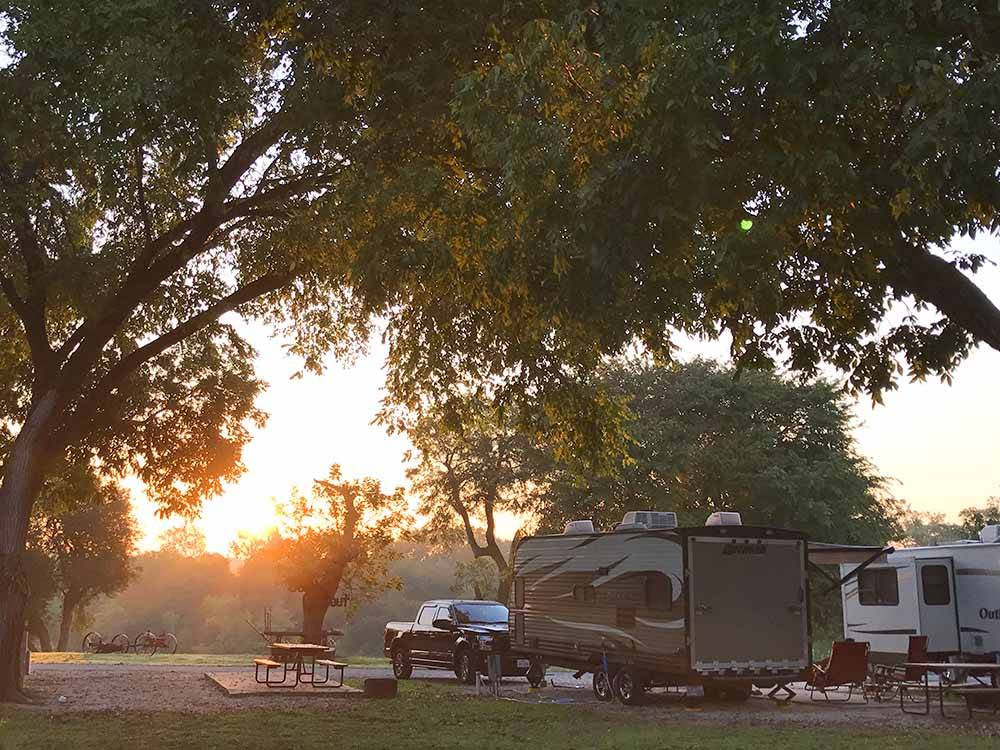 A view of the RV sites thru trees at PECAN PARK RIVERSIDE RV PARK