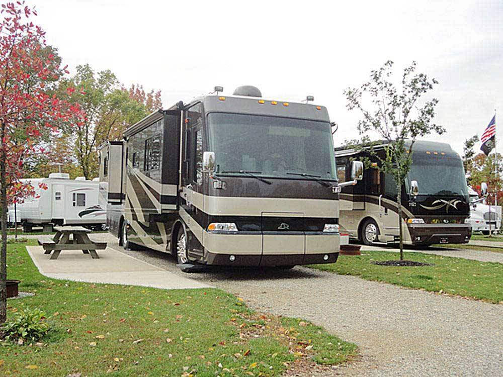 RVs parked at campsite at ARROWHEAD CAMPGROUND