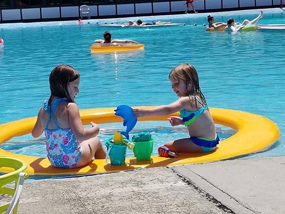 A couple of girls playing in the swimming pool at MOUNTAIN PINES CAMPGROUND