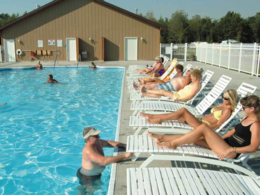 Swimming pool with outdoor seating at SILVER CREEK RV RESORT