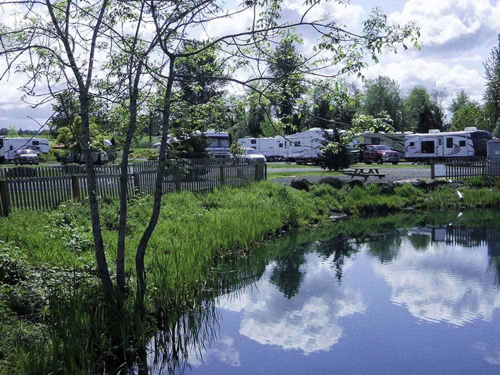 Trailers camping on the water at SILVER SPUR RV PARK