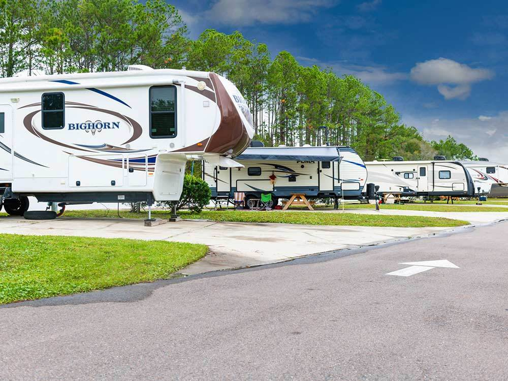 Large trailers setup on concrete spots at PECAN PARK RV RESORT