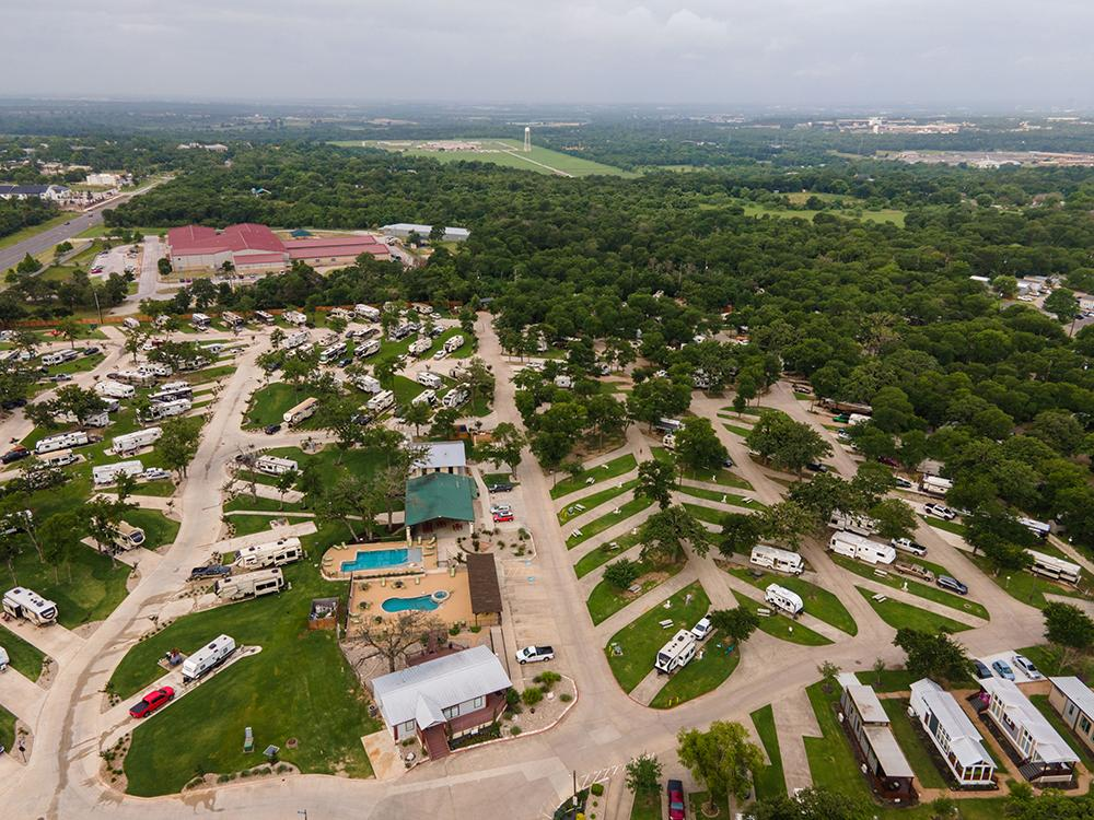 RV parked at campsite at OAK FOREST RV RESORT