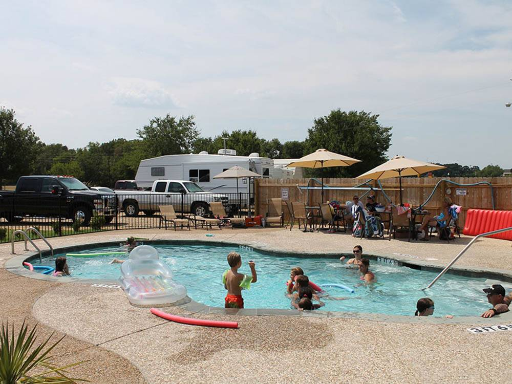 Kids swimming in pool at CANTON I-20 RV PARK