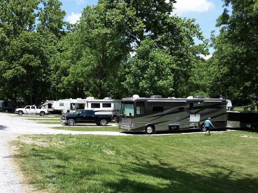 RVs and trailers at campgrounds with black truck at THREE SPRINGS CAMPGROUND