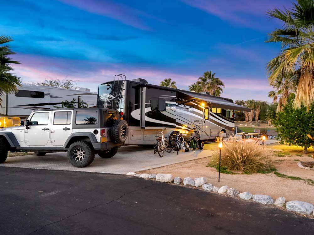 A large motorhome parked in an RV site at THE SPRINGS AT BORREGO RV RESORT  GOLF COURSE