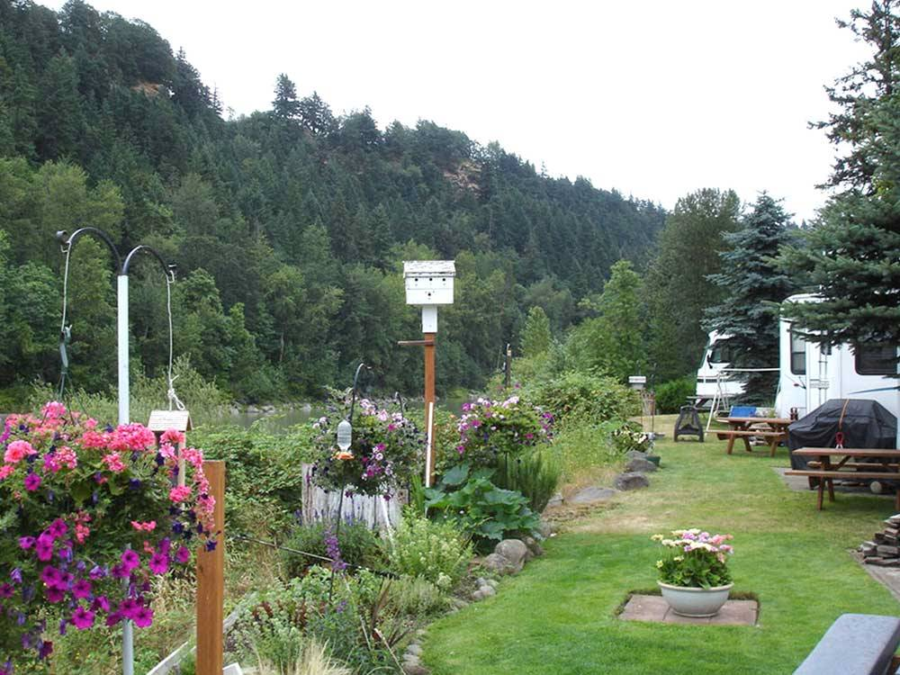 Birdhouses and flowers at SANDY RIVERFRONT RV RESORT