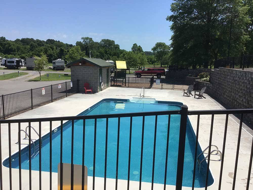 RVs parked in gravel sites with trees and grass at CAPE CAMPING  RV PARK
