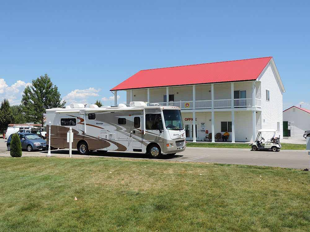 RV site with grass and picnic table at MOUNTAIN HOME RV RESORT