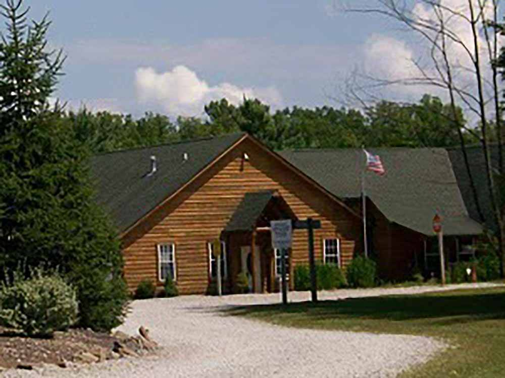 A fifth wheel trailer parked in an RV site at AMERICAN WILDERNESS CAMPGROUND