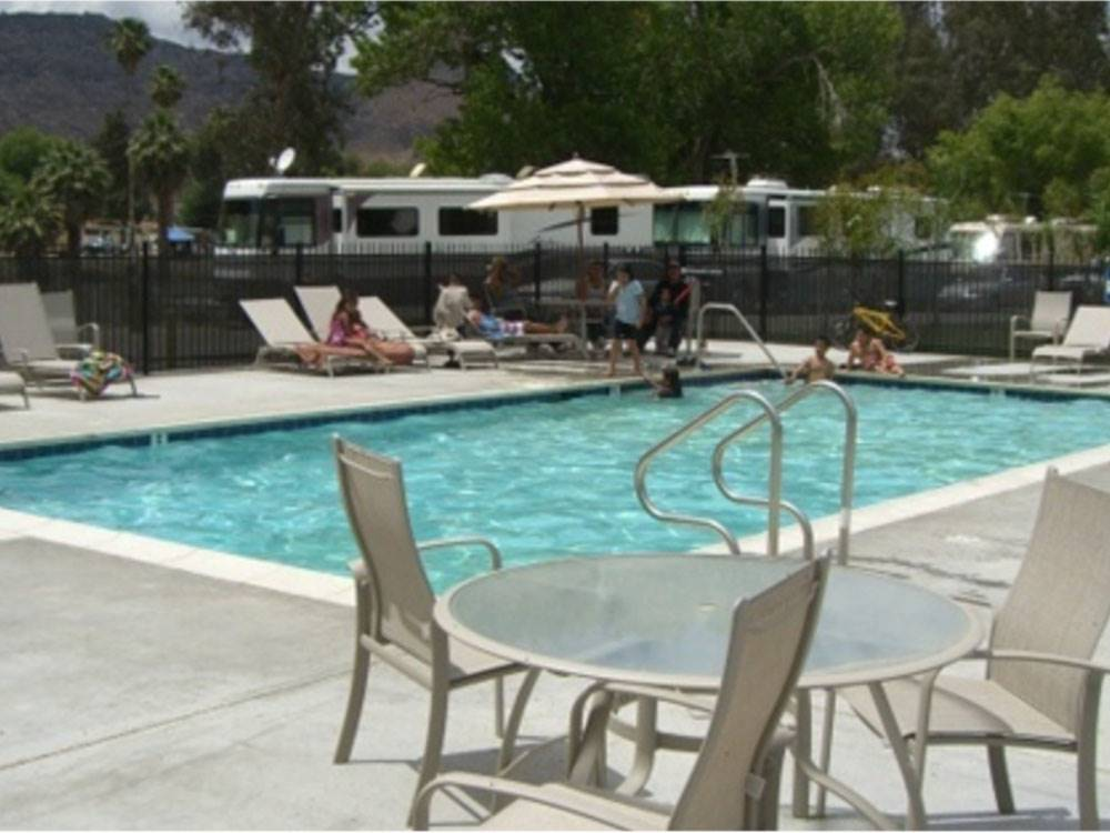 An aerial photo of the campsites and lake at REFLECTION LAKE RV PARK  CAMPGROUND