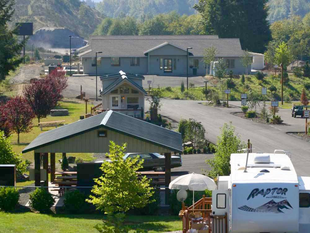 Aerial view of clubhouse with mountains in background at TOUTLE RIVER RV RESORT
