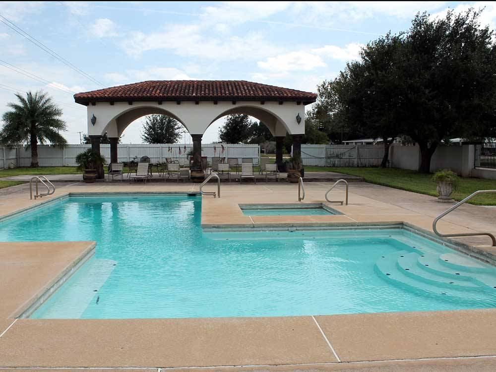 View of the swimming pool and deck area at LAZY PALMS RANCH RV PARK