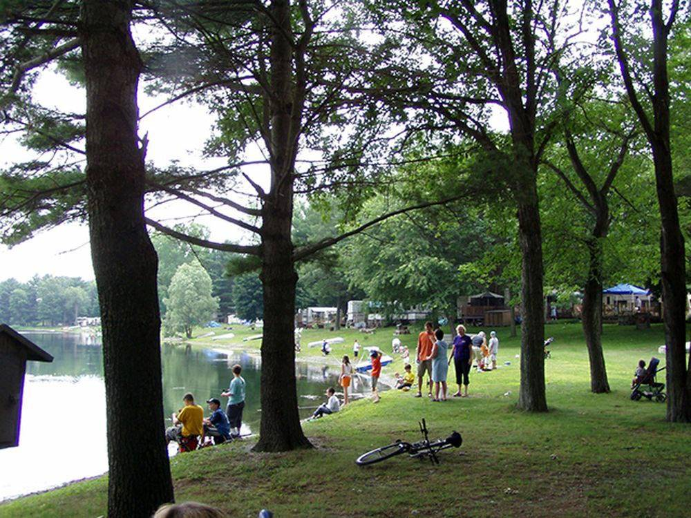 Campers enjoying lake at WAUBEEKA FAMILY CAMPGROUND