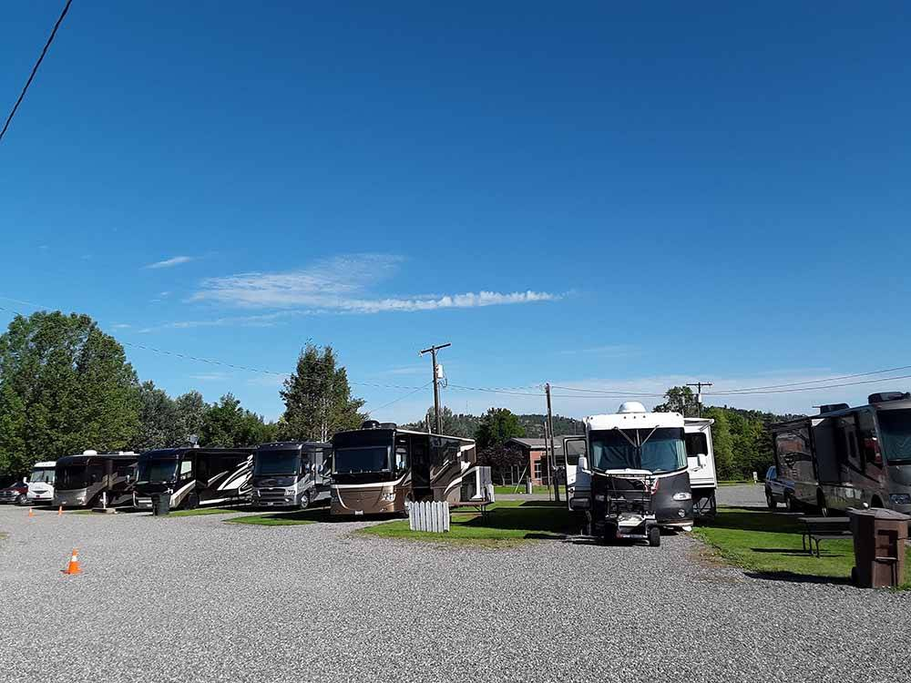 A row of gravel RV sites at OLD WEST RV PARK