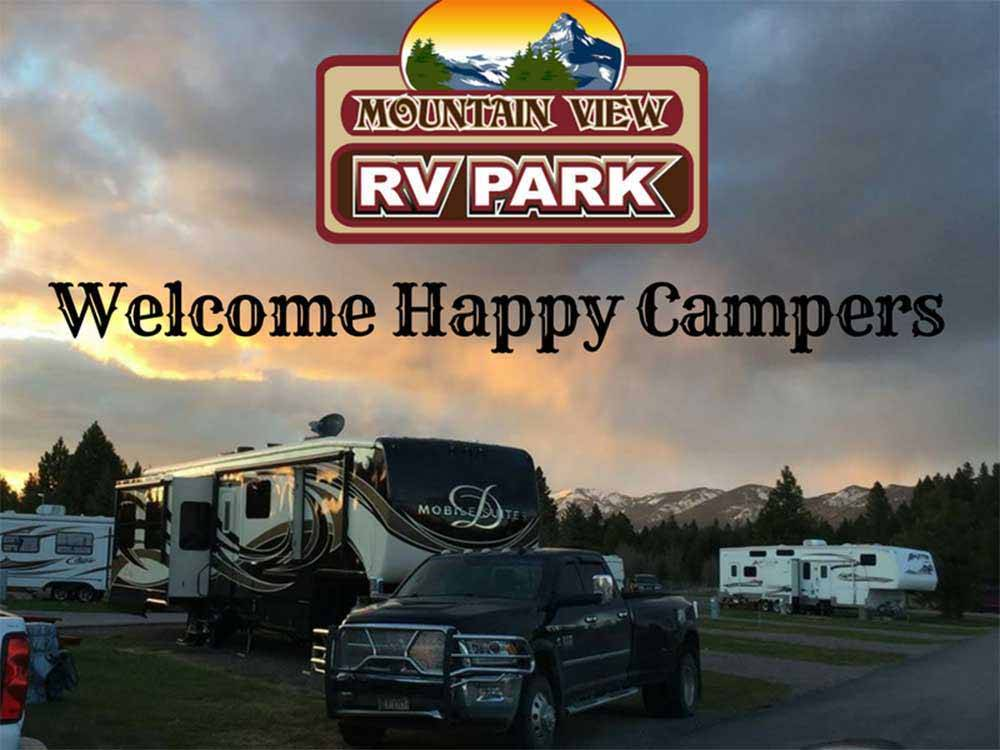 A group of RVs at dusk at MOUNTAIN VIEW RV PARK