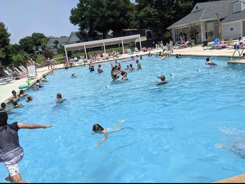 Swimming pool with outdoor seating at BRIARCLIFFE RV RESORT