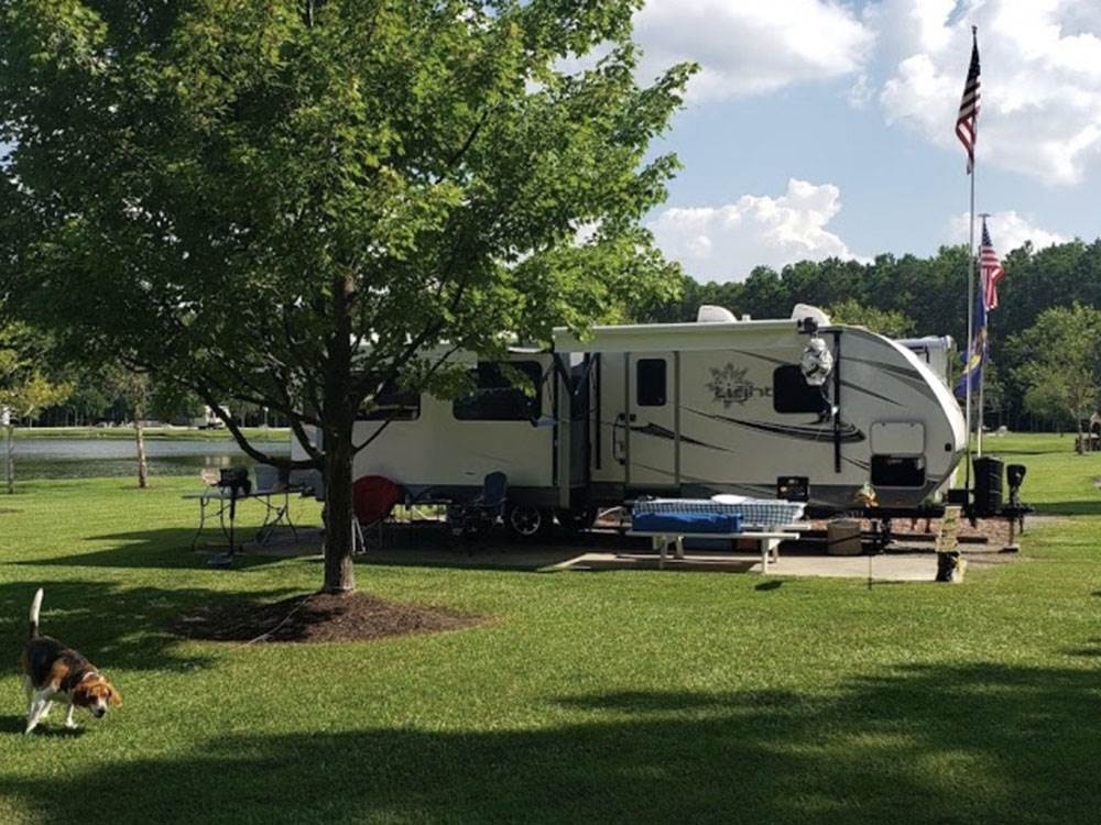 A fifth wheel parked in a concrete site at NORTH RIVER CAMPGROUND