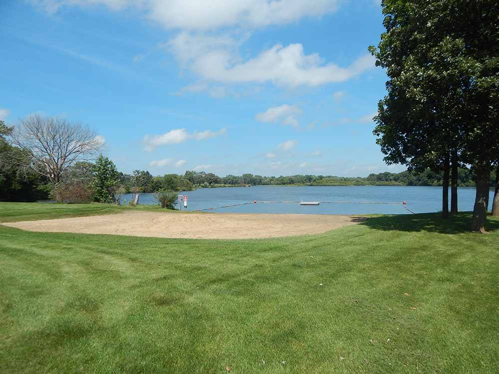 A view of the beach and grass at LAKESHORE RV RESORT  CAMPGROUND