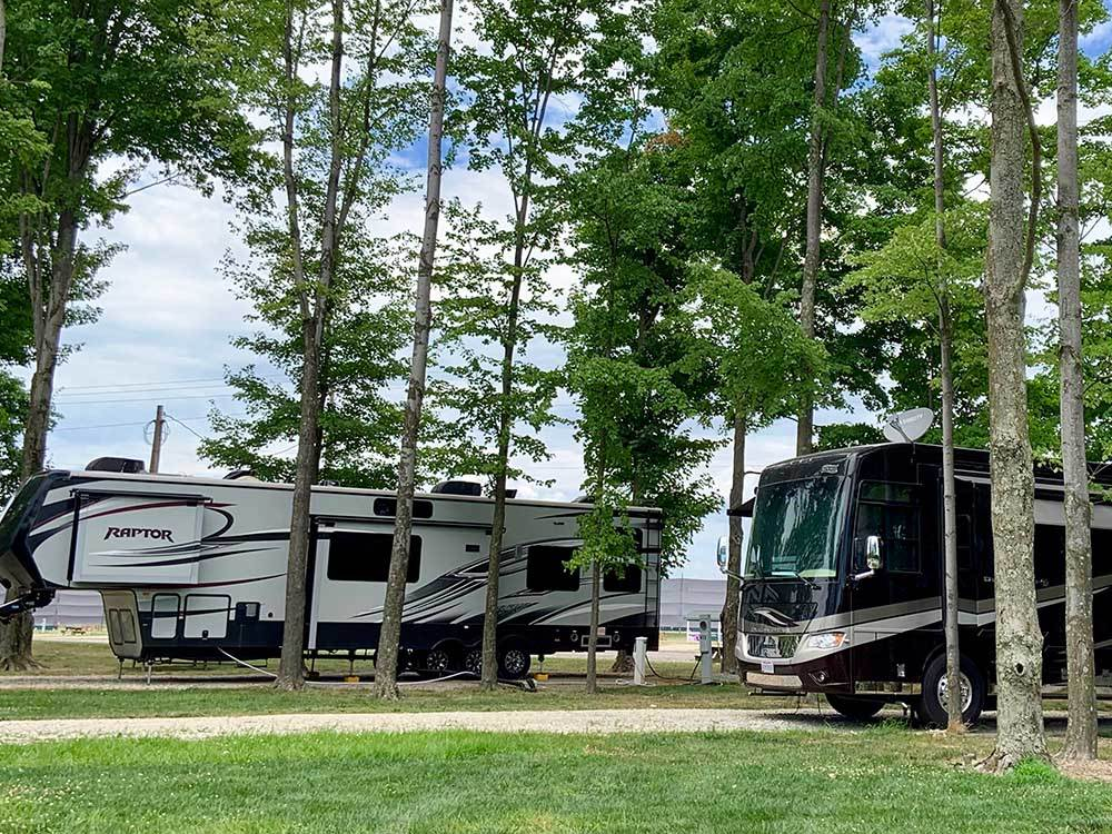 RVs parked amongst some trees at CARDINAL CENTER CAMPGROUND