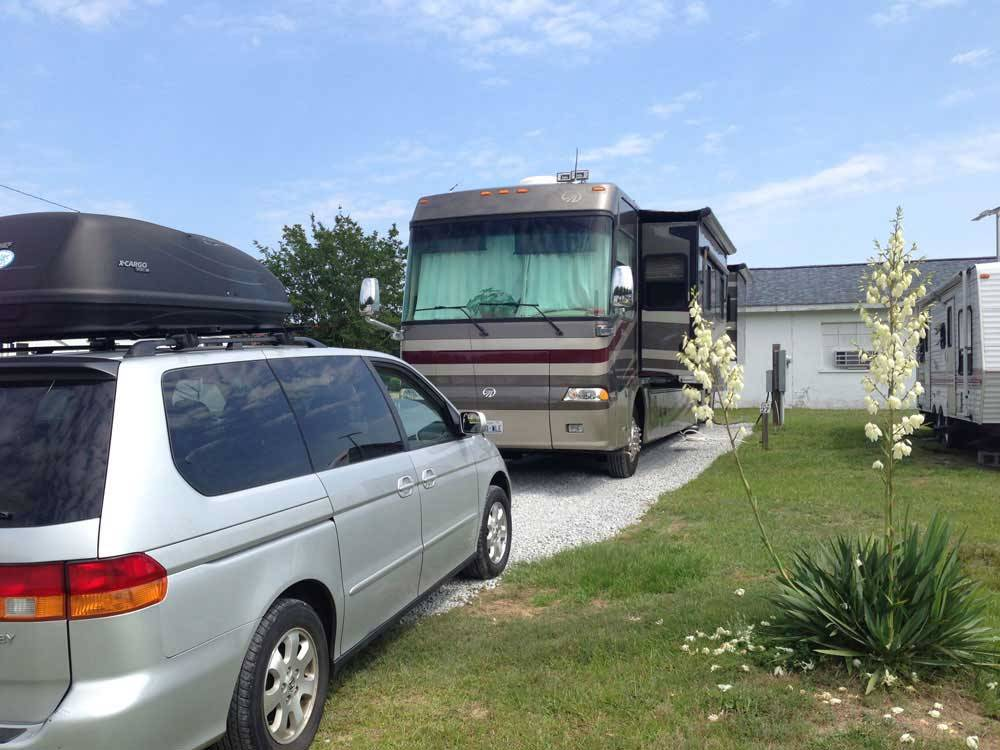 RV parked at campsite at FOUR OAKS LODGING  RV RESORT
