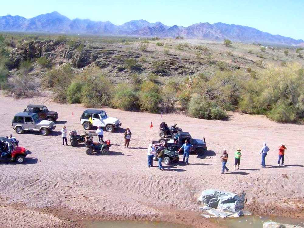 A group of people with off road vehicles at 3 DREAMERS RV PARK