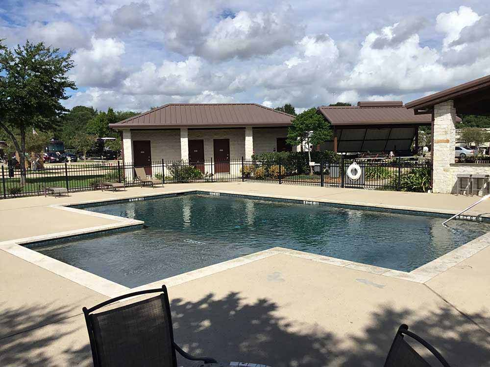 Vehicles and trailers parked along road at ADVANCED RV RESORT