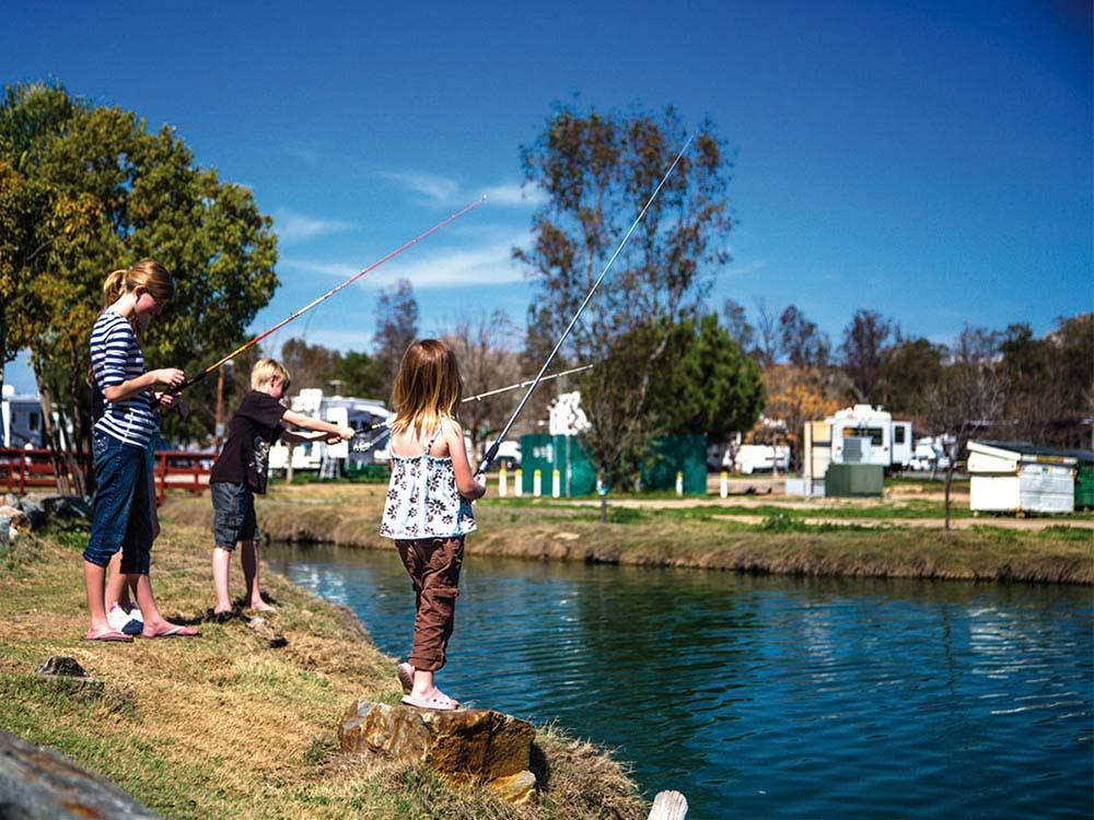 Kids fishing at WILDERNESS LAKES RV RESORT