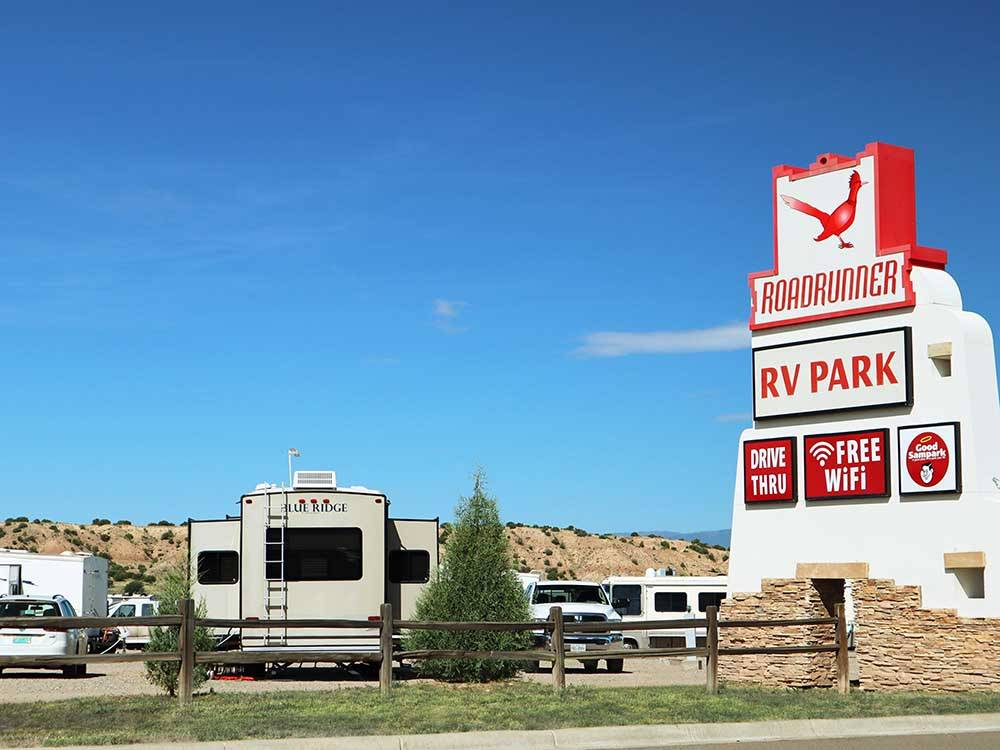 Sign at park entrance and blue distant mountains at ROADRUNNER RV PARK