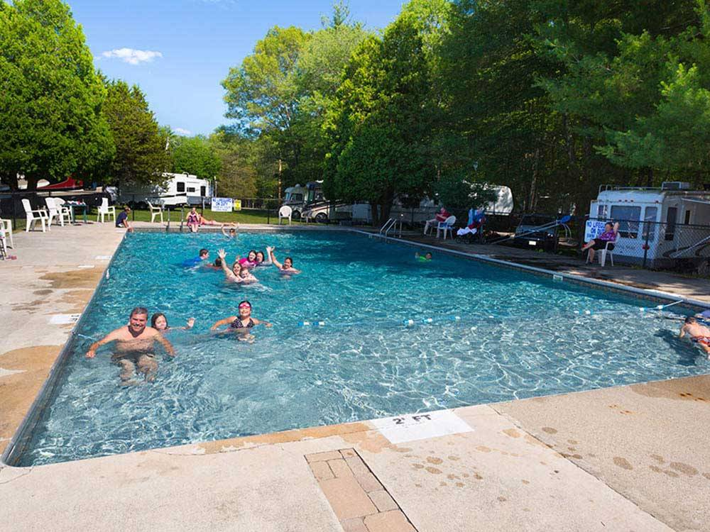 People swimming in the pool at CIRCLE CG FARM CAMPGROUND