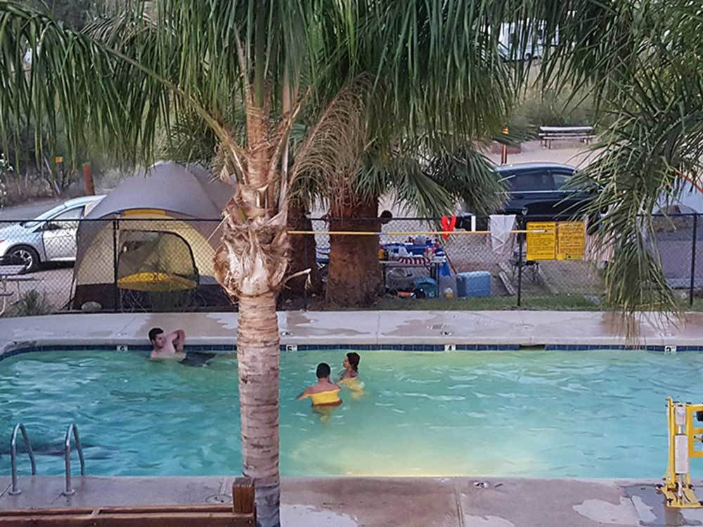 People swimming in the pool at BLACK CANYON CAMPGROUND