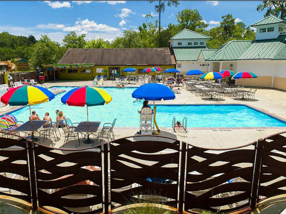 Swimming pool with outdoor seating at HOLIDAY TRAV-L-PARK