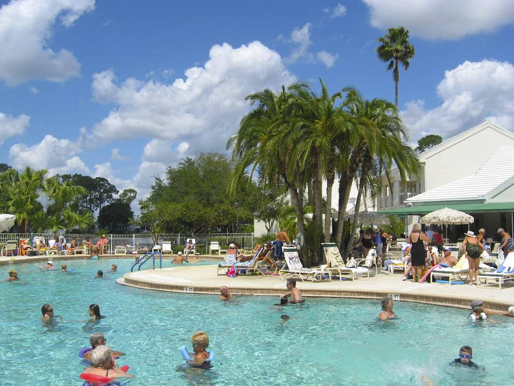 People swimming in the pool at FORT MYERS BEACH RV RESORT