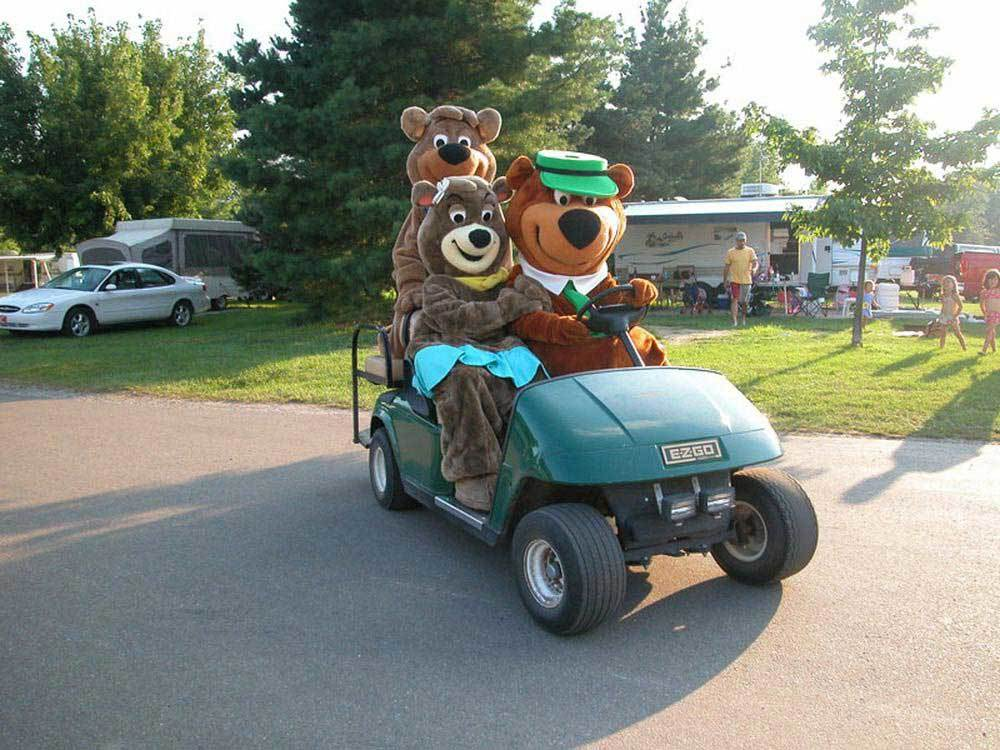 Yogi and Boo-Boo in golf cart at JELLYSTONE PARK TM AT BIRCHWOOD ACRES